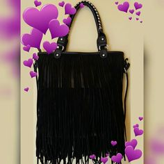 FRINGED HANDBAG Brand new with tag  Black faux leather Faux suede fringes  Fringes are double layered on both sides of handbag Zipper pocket inside  2 slip pockets inside One long shoulder strap Two shoulder handles outlined with silver design  Silver hardware on straps Bags