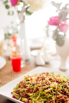 Shaved brussel and pom salad with pecan and mustard Vinaigrette