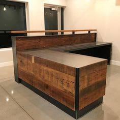 This is an L shaped reception desk made with reclaimed Louisiana Cypress and raw steel. Finish is a satin clearcoat on the wood and the steel. Picture shown is Desktop is deep and Message us for custom sizes. Steel Furniture, Cheap Furniture, Furniture Dolly, Furniture Stores, Office Reception Design, Hotel Reception Desk, Dental Office Design, Healthcare Design, Office Designs