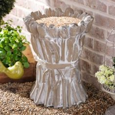 Concrete Tulip Bird Feeder Item #: 135490 Was $114.99 Clearance $59.97 Add some beautiful flowers that will never wilt to your garden with this Concrete Tulip Bird Feeder! You'll love watching birds flock to its not-so-delicate blooms. Feeder measures 20H x 16 in. in diameter. Crafted of resin and concrete. Painted antique gray finish. Gathered tulip design.   Care: Safe for outdoor use.