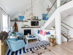 Small beach cottage living room idea with striped area rug and floating shelves. Blue chairs are great in this composition.... #beachcottage