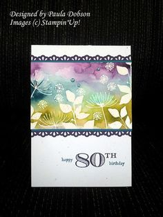 By Paula Dobson. Stamped in VersaMark & embossed in clear on watercolor paper. Dipped Aqua Painter into various re-inkers to make background. - Awesome!