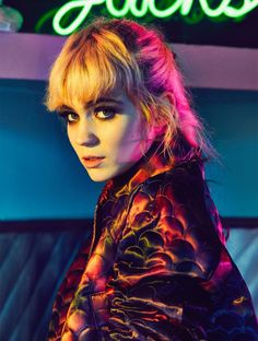 Grimes wears blunt bangs with a coat for Nylon Singapore January 2016