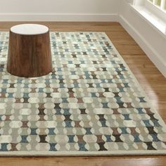 Shop Kepler Wool Rug.  Kepler's intriguing repeats of positive and negative shapes create a dynamic, statement-making rug.  The heathered color of its hand-tufted yarns adds to its vibrant appeal. Shop all patterned rugs.