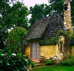 "This is a ""sneak peak"" at Hugh Comstock's studio which later became his wife's residence. It has a beautifully kept garden that discourages the photographer and tourist. Nevertheless....    The chimney is Carmel stone,""bubble stone"" shingles, hand -carved casements""and chalk-rock foundations.  blogged at talesfromcarmel.com/    This photo can be purchased at LindaYvonne.imagekind.com/"