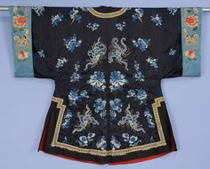 China, embroidered silk surcoat,midnight blue decorated with butterflies in forbidden stitch and satin stitch flowers in shades of blue, trimmed with brocade ribbon and black silk, brass buttons and red cotton lining, 20th c