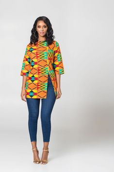 African Print Malala Kente Top The Malala Kente Top is stunning in theColorful African Print. It's comfy to wear and will make sure you stand out in a crowd African Fashion Ankara, Latest African Fashion Dresses, African Dresses For Women, African Print Fashion, African Attire, African Wear, African Tops For Women, African Print Dress Designs, African Print Dresses