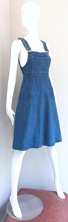 For Sale on 1stDibs - Rare early 1970s THE GAP denim overalls blue jeans dress! From one of the first to collections from The Gap in 1971. Features a fitted bodice itch an A-Line Overall Dress, Overall Shorts, Denim Overalls, Denim Jeans, Blue Jean Dress, Dress With Shawl, Jeans Dress, Fitted Bodice, Vintage 70s