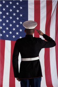 Marine salutes the flag