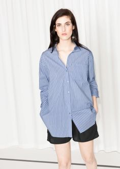 This menswear-style cotton shirt has a classic button-down design and is tailored for an oversized fit.