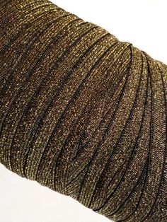 """Black with gold 5/8"""" metallic elastic. For making baby headbands, barefoot baby sandals, sewing & more. FOE, shabby rose trim, jewelry findings & more also available!"""