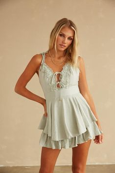 Hey babe! The Panama Ruffle Lace Romper is your new summer go-to. Featuring an embroidered lace trim v neckline, an adjustable back tie detail, and a ruffle overlay for a flowy look. Available in white and sage green. Pair with the Alaia Crocodile Slide Sandal and you'll be set for your next weekend party! Ruffle Romper, White Romper, Sorority Rush, Summer Romper, Alaia, Embroidered Lace, Size Model, Crocodile, Overlay