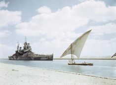 THE BRITISH BATTLESHIP HMS HOWE PASSING THROUGH THE SUEZ CANAL, 14 JULY 1944. HMS HOWE, Flagship of the Commander in Chief, Pacific Fleet, Admiral Sir Bruce Fraser, passing through the Suez Canal on her way to join the British Pacific Fleet. In the foreground is an Egyptian felucca.