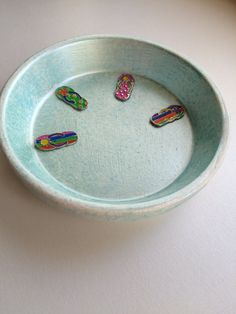 Check out this hand painted trinket dish in my Etsy shop https://www.etsy.com/listing/277147838/flip-flop-ring-dish-beach-trinket-dish