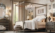 french four-poster bed, iron & crystal chandelier, ornate mirrors & artwork, soft bedding