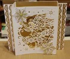 """Crafters companion angel die made into a box card, inside gold liner stamped with Stampin up """"Christ is Born"""" stamp, snowflakes using cutting dies from Paperwishes."""