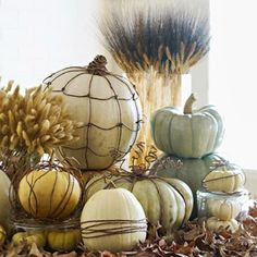 If you can't find white pumpkins, spray them in a soft white. Wrap with wire and string and arrange on pile of leaves and branches. Lovely Thanksgiving display.  #great gatherings