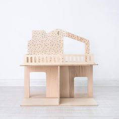 Wooden modern dollhouse made from certified plywood. Interior
