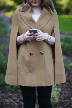 Switch out your peacoat for a classic cape in a crisp fall neutral.