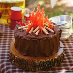 Set the stage for the perfect backyard party with our chocolate Campfire Cake topped with crackly hard-candy flames and rolled-wafer cookie logs.