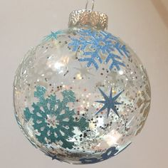 Use snowflake stickers (or cut some out of glitter paper using the Cameo) and glitter to create a lovely wintery glass ornament.