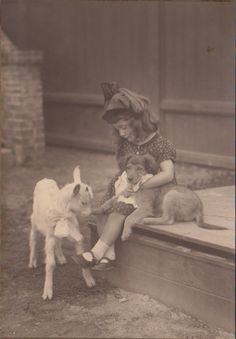 This girl whose name is Lieselotte (!) with dog (!!) and goat (!!!), 1922 | 20 Adorable Dogs Of The '20s