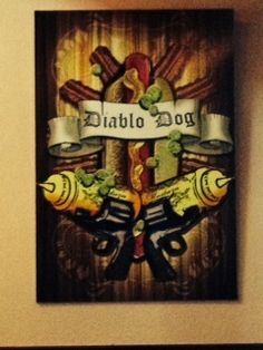 Artwork hanging in Joes Burgers in SW Portland, OR. They have great burgers and awesome fries. The Diablo Dog is an all beef hot dog wrapped in bacon  deep fried, chili, Cheddar  Jack cheese, mustard, pickled jalapenos  onions