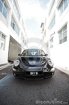 Stock Photo: Picture of black color Volkswagen New beetle car 1997 - 2010 model taken at office building in Putra Heights, Subang Jaya Malaysia.
