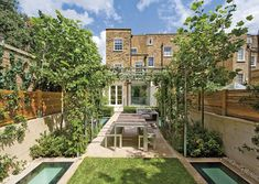 Basement extension Bright and beautiful: Windows embedded into the garden let light into the extension below