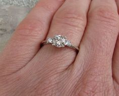 3 stone diamond ring in 10k gold, it would be better if it were square stones instead of round.