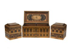 A marquetry tea chest containing two tea canisters made by William Potter of Cornhill in 1786. A mother of pearl disc inscribed, 'Made by W Potter London 1786' is set into the inside of the lid of each canister. The set is said to have been modelled after Carlton House. T