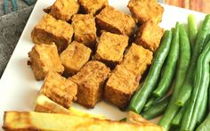<p>This simple recipe for crispy tofu is a perfect introduction into the world of using an air fryer. It's marinated in a cheesy, umami sauce, then sprinkled with brown rice flour and air fried until perfectly crispy. </p>