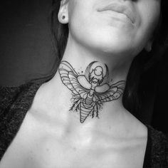 What does scarab tattoo mean? We have scarab tattoo ideas, designs, symbolism and we explain the meaning behind the tattoo. Chest Neck Tattoo, Girl Neck Tattoos, Neck Tattoos Women, Stomach Tattoos, Sleeve Tattoos, Scarab Tattoo, Beetle Tattoo, Moth Tattoo, Mini Tattoos