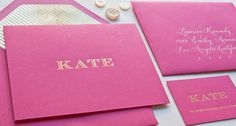 Black (instead of pink) fold-over card with logo on the front in gold and gold foil stripes lining the envelope.