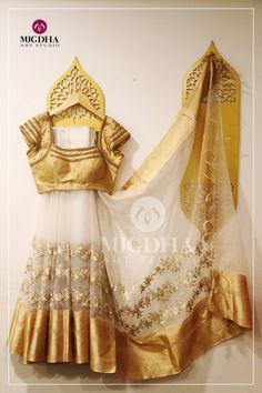 Beautiful Organza Saree with a creative touch of Hand and Machine Embroidery.