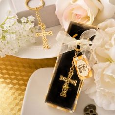 Dramatic Gold Cross Key Chain Favor (FashionCraft 6153) | Buy at Wedding Favors Unlimited (https://www.weddingfavorsunlimited.com/dramatic_gold_cross_key_chain_favor.html).