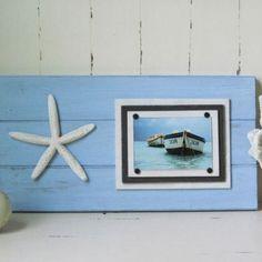 Bring the coast into your home with this gorgeous marina blue plank frame with starfish. #coastaldecor #beachdecor #sealife #starfish