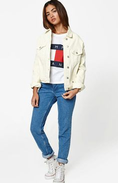 """Vintage style is taking over and Tommy Hilfiger is stepping in to deliver their must-have 90s Denim Mom Jeans. Made from a reliable rigid denim, these mom jeans boast a classic light blue wash, high-rise fit, raw cut hem for an added edge, and a relaxed fit.     FIT + SIZING    Mom jeans  High-rise  10'' rise  Relaxed fit  27"""" inseam  15"""" leg opening   FABRICATION + CARE    Light blue wash  Rigid fabric  Raw cut hem  Button closure, zip fly  100% cotton   MEASUREMENTS     Mo..."""