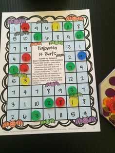 Halloween 13 Bats - players find any 2 or 3 numbers that add to 13. From Halloween math board game from Halloween Math Games Second Grade by Games 4 Learning $