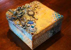 Mixed Media Steampunk style keepsake box with VIDEO TUTORIAL by Gabrielle Pollacco using Bo Bunny mixed media products (Stickable Stencils, Glimmer Sprays, Pearlescents, Glitter Pastes, Jewels and Trinkets). https://www.youtube.com/watch?v=254PucXVdlA