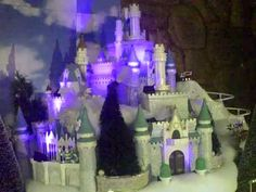 Disney Christmas village --I would love to figure out how to do something like this with our village!!