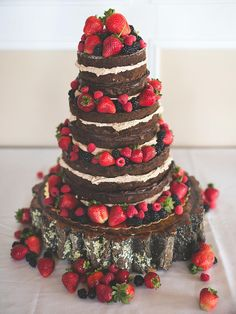 Paired with mixed berries, this naked chocolate wedding cake will have chocolate lovers running back for seconds.