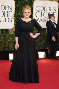 Adele Makes Her First Postbaby Appearance at the Golden Globes : Adele posed in black at the Golden Globes.