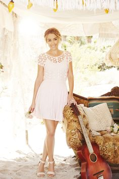 Lighten up any summer party with this sweet lace style from LC Lauren Conrad and a messy, braided updo.