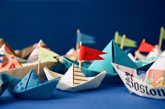 "Origami Boats Made in any type of paper: the comics, scrapbook paper, newspaper, origami paper, colorful magazine pages. Paint them add flags or streamers or sails. One pretty boat just isn't enough! - from ""A Tiny Bison"" blog"