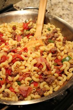 Wahlberg's American Chop Suey 1/2# bacon, slices cut into thirds 1/2# ground beef 1/2 lg onion, chopped 1/2 lg bell pepper, chopped 1 28oz can whole tomatoes 8oz elbow noodles, cooked  1/2 tbl garlic powder Directions: 1. cook the bacon until it's half-way cooked. spoon out fat save 1 tbl 2. Add beef, onions, bell peppers, garlic powder, salt and pepper. Cook, stirring occasionally, until meat is cooked. 3. Add the tomatoes and crush them by hand in the pot. Stir in the cooked pasta