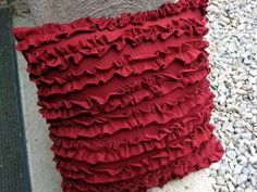 The ruffle pillow tutorial is a free, easy sewing pattern for making a pillow covered in ruffles, all made from an old T-shirt.