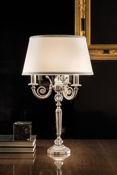 Classic table lamp, brass molded foot in antique silver finish, glass accents, white shantung shade and silver piping - Murano glass and crystal - Available on Vraiment Beau - We deliver worldwide - Référence: 20020130 Argent Antique, Antique Silver, Classic Lighting, Glass Table, Light Table, Murano Glass, Classic Style, Wall Lights, Chandelier