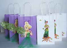 Items similar to INSPIRED Disney Tinkerbell Peter Pan Birthday Party Favor Goody Gift Bags hand made on Etsy Tinkerbell Party Theme, Tinkerbell Birthday Cakes, Fairy Birthday Party, Birthday Party Favors, 1st Birthday Parties, Birthday Party Decorations, Party Themes, Peter Pan Party, Bible Crafts For Kids