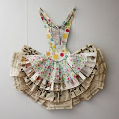"workman: ""thedanaann: Paper Tutu on Flickr. This tutu was inspired by the an artist by the name of Peter Clark. I let the size of the book pages in the skirt determine the scale of the design. I has been through several household moves, and I wanted..."
